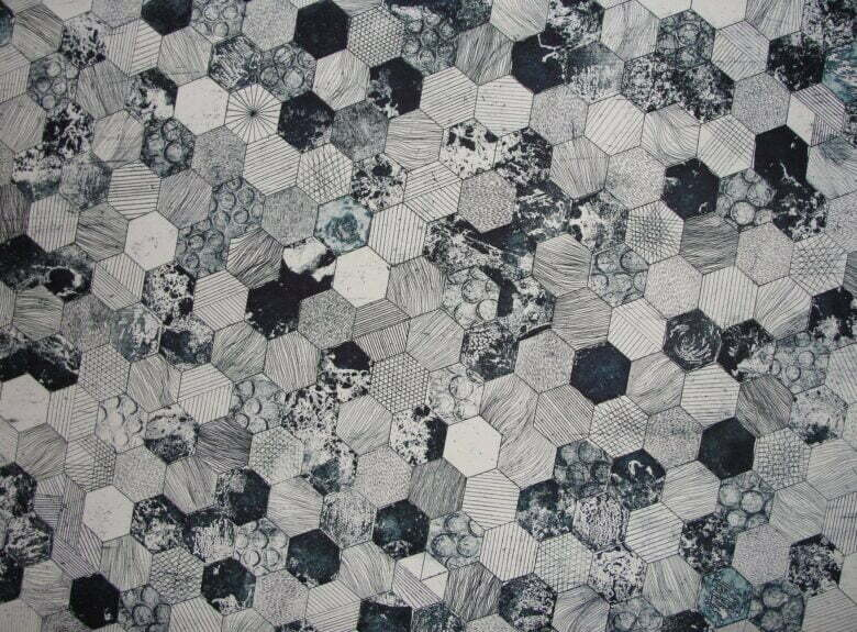 gray and black hive printed textile