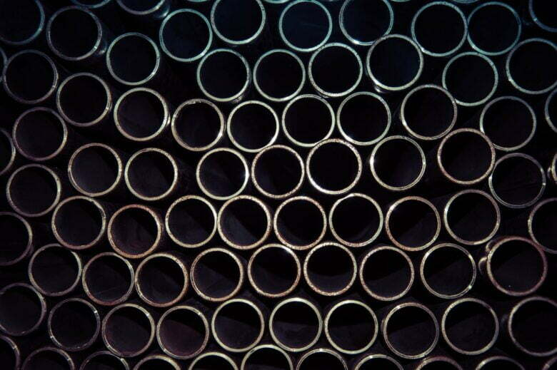 close up photo of gray metal pipes
